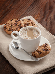 Coffee cup and biscuits on the table