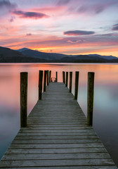 Vibrant pink and orange sunset at Ashness Jetty in the Lake District, UK.