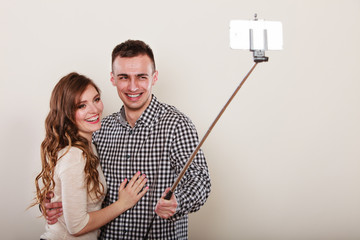 couple taking self picture with smartphone camera