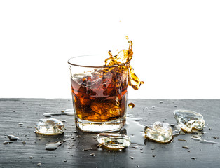 Glass cola drink with splash. Food and beverages