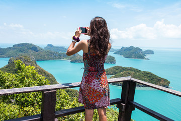Young women standing at top on of mountain Angthong Islands
