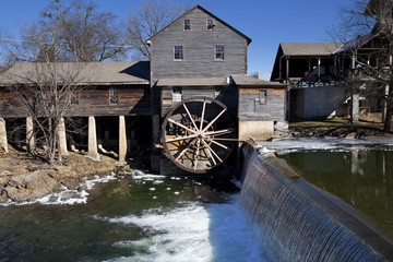 Watermill on the Little Pigeon river, in the mountain community of Pigeon Forge, Tennessee during the winter. Ice can be seen along the banks of the river