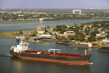 Industral tanker going around Algiers Point on the Mississippi River in New Orleans, Louisiana with Bywater, Holy Cross and Lower Ninth Ward in the background.
