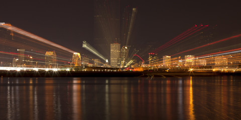 Abstract of downtown New Orleans, Louisiana from the Mississippi River at night. Photo Zoom effect