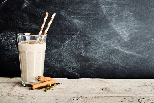 Vanilla smoothie in a tall glass with cinnamon