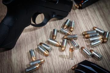 Guns and ammunition on wooden