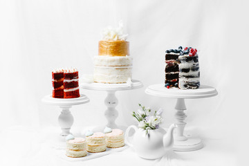 Decorated red, brown, white and golden naked cake rustic style for weddings, birthdays and events