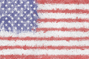 Flag of the United States of America created from splash colours painted  on textile texture background. USA flag.