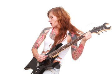 Attractive redhead punk girl with tattoos playing electrical guitar