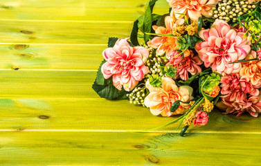 Mixed flowers bouquet on wood background.