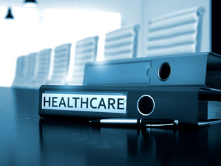 Healthcare. Illustration on Toned Background. Healthcare - Illustration. Healthcare - Ring Binder on Wooden Black Desktop. Healthcare - Business Concept on Blurred Background. 3D.