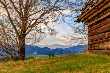 view of mountain and old wooden house