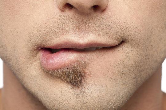 male biting his lips