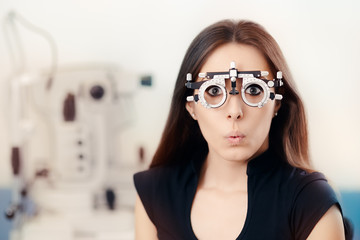 Funny Girl at Ophthalmology Exam Wearing Eye Test Glasses