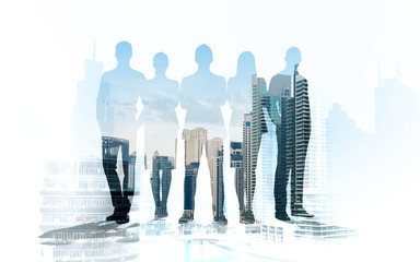business people silhouettes over city background