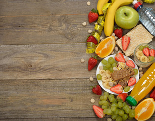 Various fruits on a wooden background