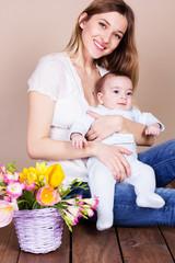 Pretty mom with baby boy in studio