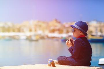 little boy taking photos while travel in Europe, Malta
