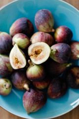 Fresh California figs on a blue plate
