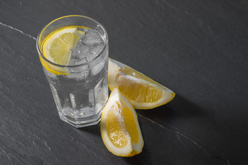 Glass of water on stone background
