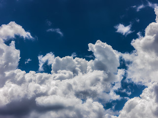 White dramatic clouds with a deep blue sky background.