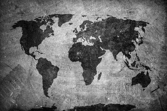 Retro world map on concrete, plaster wall. Vintage, grunge background.