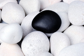 """Being different, stand out of a crowd conceptual, zen stones with words """"be yourself""""."""