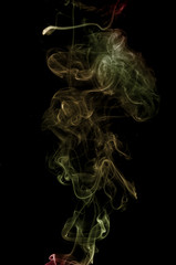 Colorful smoke on the black background