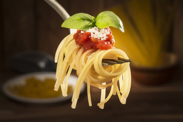 fork with spaghetti and tomato sauce in the kichen