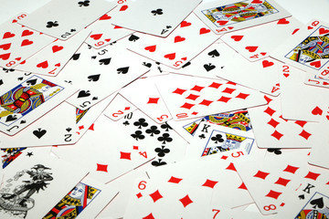 Playing cards laid out on a white background