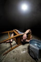 Prisoner being punished with cruel interrogation technique of waterboarding