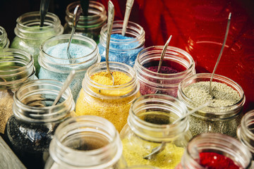 Close up of jars of pigment powder