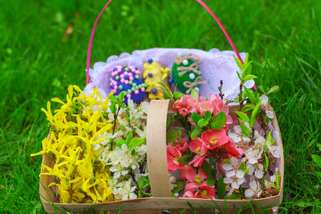 basket of flowers and a basket with Easter eggs