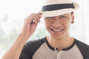 Smiling Chinese man wearing straw hat