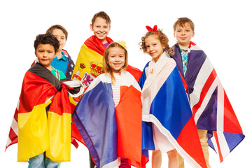 Group of kids wrapped in European nations flags