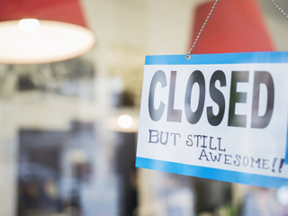 Close up of unique closed sign in window