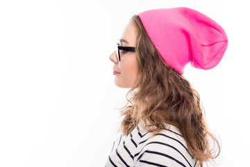 Portrait of young hipster girl in glasses and pink hat
