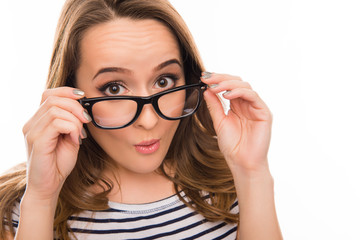 Close up portrait of surprised woman in glasses and striped T-sh
