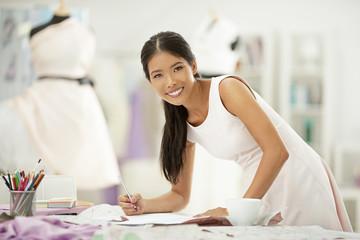 Fashion designer drawing in studio