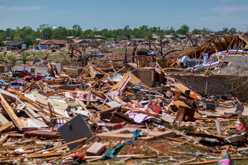 Propane Tanks Lined Up in front of debris from a destructive tornado
