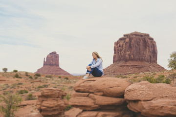 Caucasian woman admiring rock formations in Monument Valley, Utah, United States