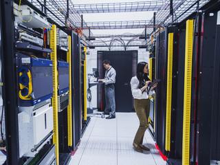 Technicians working in server room