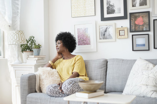African American woman relaxing on sofa
