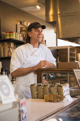 Caucasian baker working in bakery
