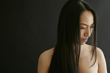 Smiling mixed race woman with long hair