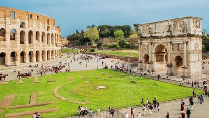 Wall Mural - Time lapse with aerial view of the Colosseum and the Arch of Constantine, Rome, Italy