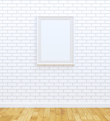 Blank white picture frame on white brick wall