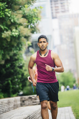 Indian man jogging in city