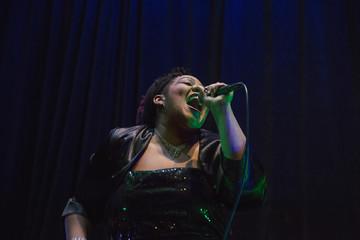 Black singer performing on stage