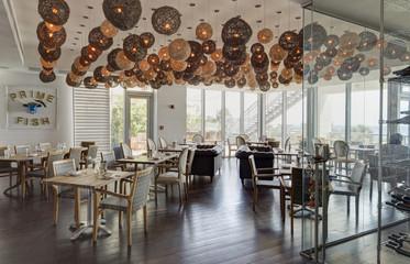 Lanterns over tables in restaurant